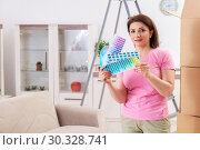 Купить «Woman choosing color for flat renewal», фото № 30328741, снято 27 декабря 2018 г. (c) Elnur / Фотобанк Лори
