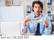 Купить «Young handsome businessman in budget planning concept», фото № 30329697, снято 13 ноября 2018 г. (c) Elnur / Фотобанк Лори