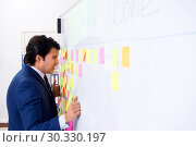 Купить «Young handsome employee in front of whiteboard with to-do list», фото № 30330197, снято 16 октября 2018 г. (c) Elnur / Фотобанк Лори