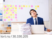 Купить «Young handsome employee in front of whiteboard with to-do list», фото № 30330205, снято 16 октября 2018 г. (c) Elnur / Фотобанк Лори
