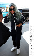 Купить «Blac Chyna arrives at Los Angeles International Airport in a blue tracksuit Featuring: Blac Chyna Where: Los Angeles, California, United States When: 02 Sep 2017 Credit: WENN.com», фото № 30342065, снято 2 сентября 2017 г. (c) age Fotostock / Фотобанк Лори