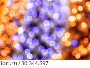 Купить «Abstract festive magic shiny disco background in purple lilac and golden yellow with bokeh effect for congratulation or poster for New Year, Merry Christmas, holiday», фото № 30344597, снято 27 февраля 2019 г. (c) Светлана Евграфова / Фотобанк Лори