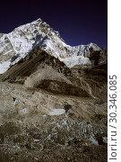 Купить «NEPAL Khumbu Glacier -- Dec 2005 -- The top of the Khumbu Glacier, a popular climbing route to the summit of Mount Everest (upper right) this glacier has...», фото № 30346085, снято 17 июля 2019 г. (c) age Fotostock / Фотобанк Лори