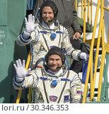Купить «BAIKONUR COSMODROME, KAZAKHSTAN - 11 Oct 2018 - ISS Expedition 57 crewmembers Alexey Ovchinin of Roscosmos and Nick Hague of NASA (pictured here earlier...», фото № 30346353, снято 11 октября 2018 г. (c) age Fotostock / Фотобанк Лори