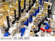 Купить «A variety of plumbing pipe connectors, corners, fittings, nipples.», фото № 30346885, снято 12 февраля 2019 г. (c) Андрей Радченко / Фотобанк Лори
