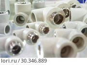 Купить «PPR Plumbing connection fittings for plastic pipes.», фото № 30346889, снято 12 февраля 2019 г. (c) Андрей Радченко / Фотобанк Лори