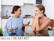 Купить «Friends having expressional talking», фото № 30347437, снято 29 августа 2018 г. (c) Яков Филимонов / Фотобанк Лори