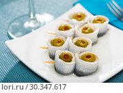 Купить «Appetizing herring rolls with olives on skewers», фото № 30347617, снято 27 марта 2019 г. (c) Яков Филимонов / Фотобанк Лори