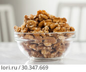 Купить «Close up of raw peeled walnut on white background», фото № 30347669, снято 24 марта 2019 г. (c) Яков Филимонов / Фотобанк Лори
