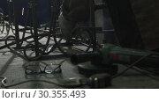 Купить «Glasses And A Metal Saw Are Lying On The Table», видеоролик № 30355493, снято 16 июля 2020 г. (c) Pavel Biryukov / Фотобанк Лори