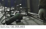 Купить «Worker In The Forge Marks The Required Length», видеоролик № 30355893, снято 16 июля 2020 г. (c) Pavel Biryukov / Фотобанк Лори