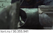 Купить «Hands Of A Blacksmith Connect The Two Sides Of A Forged Item», видеоролик № 30355941, снято 21 июля 2019 г. (c) Pavel Biryukov / Фотобанк Лори