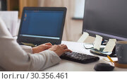 Купить «programmer typing on computer keyboard at office», видеоролик № 30356461, снято 18 марта 2019 г. (c) Syda Productions / Фотобанк Лори
