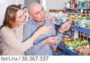 Купить «chooses different candies in a package», фото № 30367337, снято 11 апреля 2018 г. (c) Яков Филимонов / Фотобанк Лори