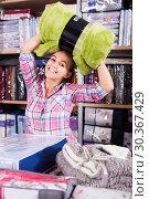 Купить «Happy woman shopper buying new blanket and coverlet», фото № 30367429, снято 24 марта 2019 г. (c) Яков Филимонов / Фотобанк Лори