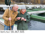 Купить «Owner of sturgeon farm giving instruction to female», фото № 30367505, снято 4 февраля 2018 г. (c) Яков Филимонов / Фотобанк Лори