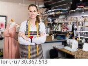 Купить «Portrait of woman designer who is standing on her workplace in time designing new collection», фото № 30367513, снято 5 мая 2018 г. (c) Яков Филимонов / Фотобанк Лори