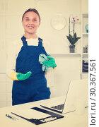 Купить «female cleaner with duster», фото № 30367561, снято 21 апреля 2019 г. (c) Яков Филимонов / Фотобанк Лори