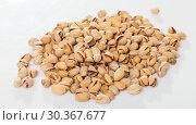 Купить «Dried kernels of pistachios», фото № 30367677, снято 20 января 2020 г. (c) Яков Филимонов / Фотобанк Лори