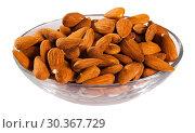 Купить «Image of roasted salt almonds on glass bowl, nobody», фото № 30367729, снято 17 июля 2019 г. (c) Яков Филимонов / Фотобанк Лори