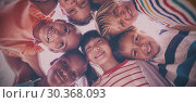 Купить «Portrait of schoolkids forming huddle», фото № 30368093, снято 24 марта 2019 г. (c) Wavebreak Media / Фотобанк Лори