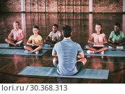 Купить «School kids and teacher meditating during yoga class», фото № 30368313, снято 20 мая 2019 г. (c) Wavebreak Media / Фотобанк Лори