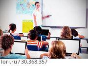 Купить «Children using digital tablets with teacher teaching», фото № 30368357, снято 9 апреля 2020 г. (c) Wavebreak Media / Фотобанк Лори