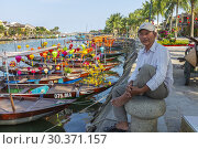 Купить «Local Vietnamese fisherman sitting on a capstan at the side of the harbour on Son Thu Bon river, Hoi An, Quang Nam Provence, Vietnam, Asia.», фото № 30371157, снято 5 февраля 2019 г. (c) age Fotostock / Фотобанк Лори
