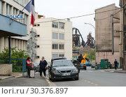 Купить «France, Lorraine, Hayange - structurally weak city, elected 2014 front national politician mayor, rear blast furnaces of shut down steelworks, left gendarmerie», фото № 30376897, снято 2 мая 2018 г. (c) Caro Photoagency / Фотобанк Лори
