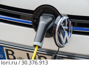 Купить «Charging process on an electric car from VW», фото № 30376913, снято 13 марта 2017 г. (c) Caro Photoagency / Фотобанк Лори