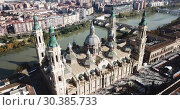 Купить «Aerial view of Zaragoza with Cathedral-Basilica of Our Lady of Pillar on bank of Ebro river, Spain», видеоролик № 30385733, снято 24 декабря 2018 г. (c) Яков Филимонов / Фотобанк Лори