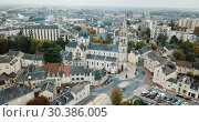 Купить «Aerial view of picturesque Chateauroux cityscape with Catholic Church of Our Lady, central France», видеоролик № 30386005, снято 26 октября 2018 г. (c) Яков Филимонов / Фотобанк Лори