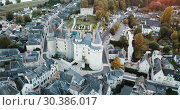 Купить «Aerial view of medieval castle of Chateau de Langeais located in commune of same name in Indre-et-Loire department, France», видеоролик № 30386017, снято 25 октября 2018 г. (c) Яков Филимонов / Фотобанк Лори
