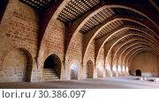 Купить «Unique architecture of ancient monastic dormitory in Monastery of Santa Maria de Santes Creus, Catalonia, Spain», видеоролик № 30386097, снято 11 февраля 2019 г. (c) Яков Филимонов / Фотобанк Лори