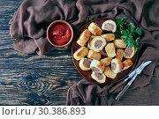 Купить «sausage rolls on a plate, flat lay», фото № 30386893, снято 19 февраля 2019 г. (c) Oksana Zh / Фотобанк Лори