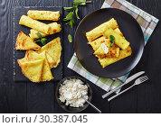 Купить «crepes roll up filled with sweet white cheese», фото № 30387045, снято 6 марта 2019 г. (c) Oksana Zh / Фотобанк Лори