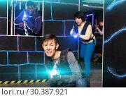Купить «Chinese man during lasertag game in dark room», фото № 30387921, снято 23 января 2019 г. (c) Яков Филимонов / Фотобанк Лори