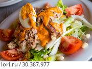 Купить «Salad Xatonada with canned tuna and salted anchovies», фото № 30387977, снято 26 мая 2019 г. (c) Яков Филимонов / Фотобанк Лори