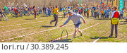 Купить «Russia, Samara, April 2017: children's relay race, together with their parents for the opening of the bike season in the city park on a spring sunny day.», фото № 30389245, снято 29 апреля 2017 г. (c) Акиньшин Владимир / Фотобанк Лори