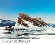 Купить «View of rock Elenka on a sunny winter day. Lake Baikal, Olkhon island. Eastern Siberia, Russia», фото № 30389929, снято 15 марта 2019 г. (c) Наталья Волкова / Фотобанк Лори