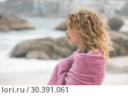 Купить «Woman standing on beach », фото № 30391061, снято 12 ноября 2018 г. (c) Wavebreak Media / Фотобанк Лори