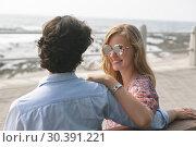 Купить «Caucasian couple standing on the promenade with arm around on a sunny day», фото № 30391221, снято 12 ноября 2018 г. (c) Wavebreak Media / Фотобанк Лори