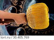 Купить «Hand hit big gong in temple», фото № 30405769, снято 25 октября 2013 г. (c) easy Fotostock / Фотобанк Лори