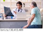 Купить «Old man visiting young male doctor», фото № 30413489, снято 9 января 2019 г. (c) Elnur / Фотобанк Лори
