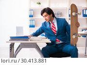 Купить «Young handsome businessman with longboard in the office», фото № 30413881, снято 11 декабря 2018 г. (c) Elnur / Фотобанк Лори