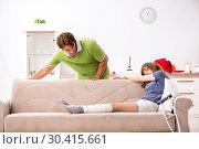 Купить «Husband helping leg injured wife in housework», фото № 30415661, снято 4 октября 2018 г. (c) Elnur / Фотобанк Лори