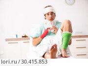 Купить «Young injured man staying in the hospital», фото № 30415853, снято 2 октября 2018 г. (c) Elnur / Фотобанк Лори