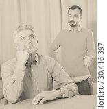 Купить «Son criticizes his mature father», фото № 30416397, снято 16 июня 2019 г. (c) Яков Филимонов / Фотобанк Лори