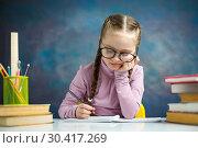 Купить «Cute Primary Schoolgirl Do Homework Read Textbook», фото № 30417269, снято 9 февраля 2019 г. (c) Иван Карпов / Фотобанк Лори