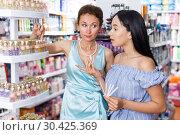 Купить «Girl and mother smelling perfume testers, choosing perfume», фото № 30425369, снято 21 июня 2018 г. (c) Яков Филимонов / Фотобанк Лори